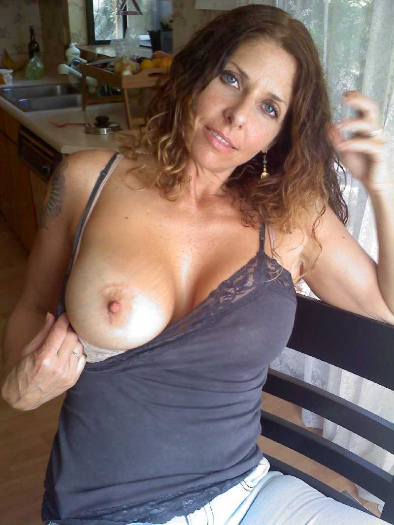 Pointy Boobs - One tit out on this girl.""