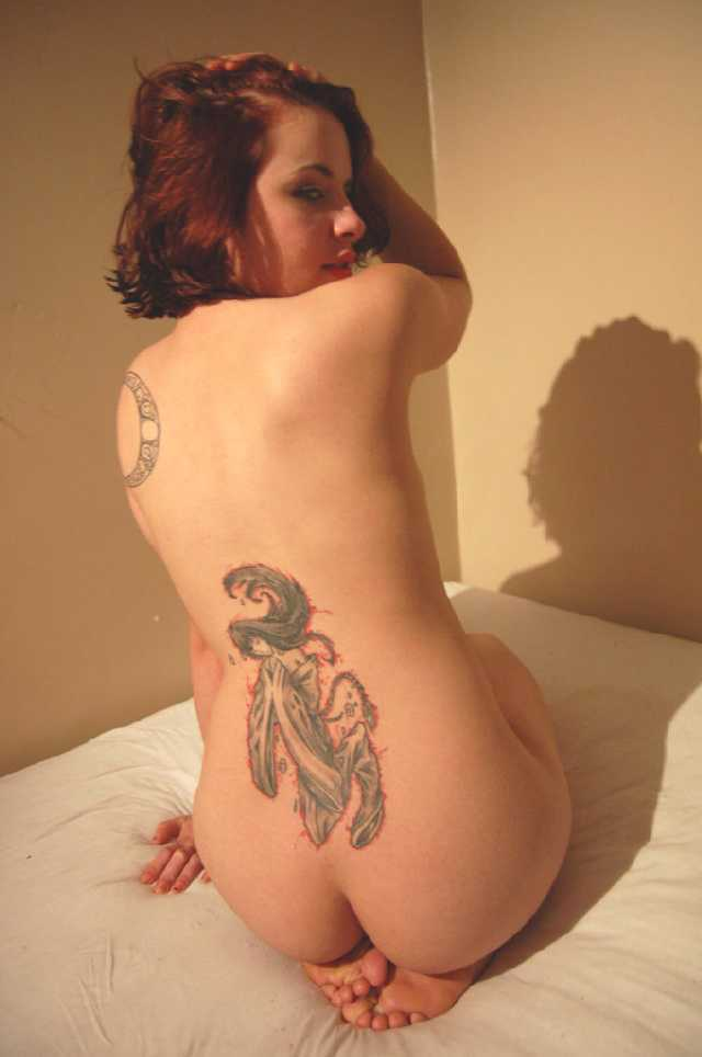 this girl is naked and has a tatoo on her back nude amateurs truth